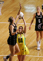 24.07.2007 Silver Ferns Casey Willimas looks to block the shot of Australian Sharelle McMahon during the Silver Ferns v Australia second netball test in Adelaide, Australia. Mandatory Photo Credit ©Michael Bradley. **$150 + GST USAGE FEE DOES APPLY**