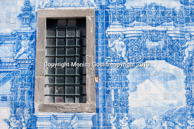 Detail of the azulejos (blue and white tiles) on the facade of the Capela das Almas in Porto, Portugal.