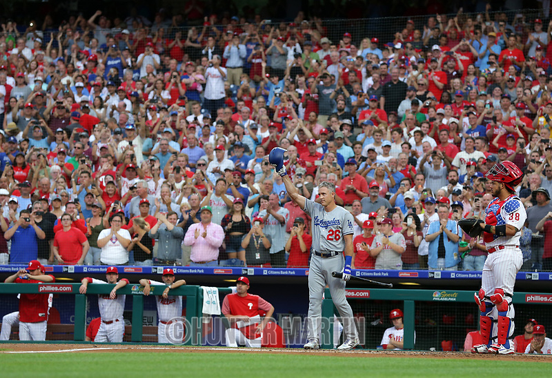 PHILADELPHIA, PA - JULY 23: Chase Utley #26 of the Los Angeles Dodgers acknowledges a standing ovation before his first at bat in the second inning during a game against the Philadelphia Phillies at Citizens Bank Park on July 23, 2018 in Philadelphia, Pennsylvania. (Photo by Hunter Martin/Getty Images) *** Local Caption *** Chase Utley