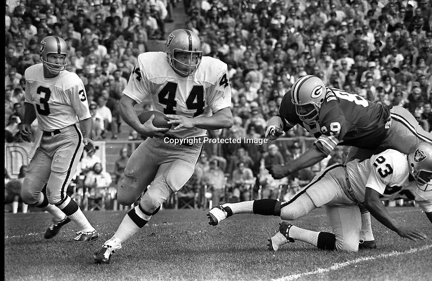 Oakland Raiders fullback Marv Hubbard gets a block from Charlie Smith, #3 Daryle Lamonica hands off, <br />agains the Green Bay Packers. (1972 photo by Ron Riesterer)