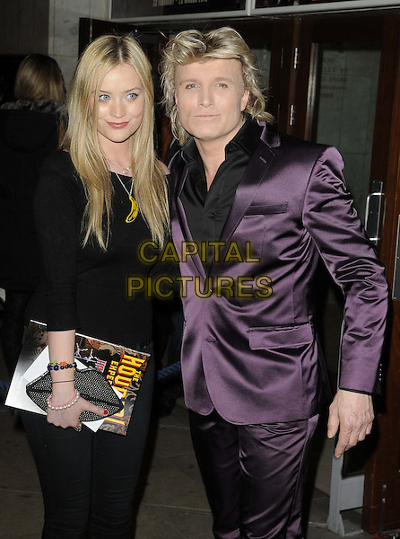 Laura Whitmore & Hans Klok.Hans Klok's 'The Houdini Experience' Press Night at the Peacock Theatre, London, England..February 28th 2012.half 3/4 dress length black shirt purple suit  .CAP/CAN.©Can Nguyen/Capital Pictures.