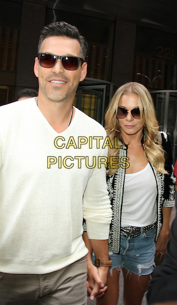 NEW YORK, NY - JULY 17: Eddie Cibrian, LeAnn Rimes at SiriusXM to talk about the new reality series on Vh1 'LeAnn &amp; Eddie' on July 17, 2014 in New York. <br /> CAP/MPI/RW<br /> &copy;RW/MediaPunch/Capital Pictures