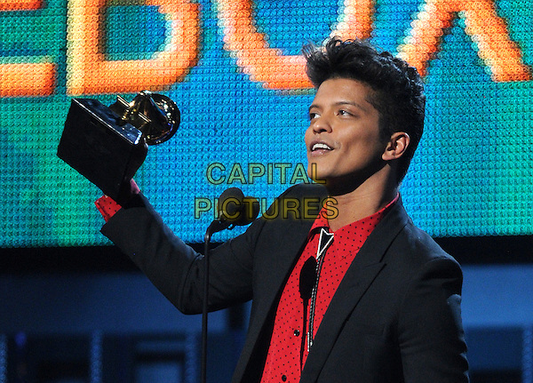 LOS ANGELES, CA - JANUARY 26 : Bruno Mars accepts the Best Pop Vocal Album award for 'Unorthodox Jukebox' onstage at The 56th Annual GRAMMY Awards at Staples Center on January 26, 2014 in Los Angeles, California. <br /> CAP/MPI/PG<br /> &copy;PGFMicelotta/MediaPunch/Capital Pictures