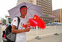 Aug. 6, 2008; Beijing, CHINA; A Chinese vendor sells flags near Tiananmen Square in Beijing. The Olympics begin at 8pm on August 8, 2008. Mandatory Credit: Mark J. Rebilas-