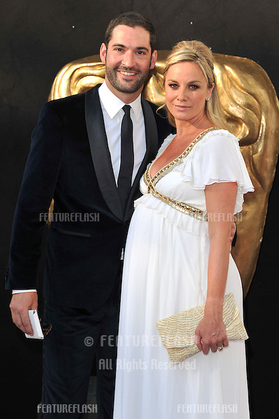 Tom Ellis and Tamsin Outhwaite arriving for the BAFTA TV Awards 2012 at the Royal Festival Hall, South Bank, London. 27/05/2012 Picture by: Steve Vas / Featureflash