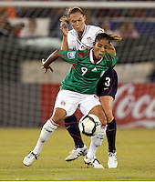 Maribel Dominguez of Mexico (L) and Christie Rampone of USA (R) during the semifinal match of CONCACAF Women's World Cup Qualifying tournament held at Estadio Quintana Roo in Cancun, Mexico. Mexico 2, USA 1.