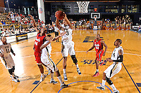 21 January 2012:  FIU guard-forward Dominique Ferguson (3) beats FAU guard-forward Kelvin Penn (44) to a rebound in the first half as the Florida Atlantic University Owls defeated the FIU Golden Panthers, 66-64, at the U.S. Century Bank Arena in Miami, Florida.