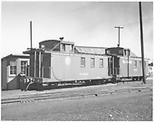 End-side angle view of long caboose #04990, round herald; long caboose #0517, flying herald; at Alamosa.<br /> D&amp;RGW  Alamosa, CO  1939