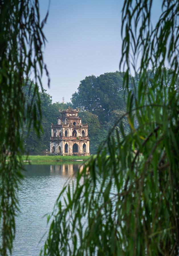 HANOI, VIETNAM - CIRCA SEPTEMBER 2014: View of the Turtle Tower, a famous landmark over the Hoan Kiem Lake, in Hanoi.