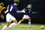 SIOUX FALLS, SD - NOVEMBER 1:  Tia Ferrando #14 from the University of Sioux Falls pushes the ball against Augustana in the first half of their game Friday night at the USF Sports Complex. (Photo by Dave Eggen/Inertia)
