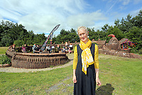 Pictured: Artist Gwen Heeney by her creation, the mythical beast Saturday 13 August 2016<br />Re: Grow Wild event at  Furnace to Flowers site in Ebbw Vale, Wales, UK