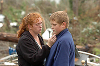 Becky Nolan and her son Edwin Burch, 11,  look at the debris left of their home in the Cooter Pond neighborhood in Lake County, Fl.  A tornado hit the area in the early morning Thursday. Her husband William Nolan died trying to save their 7-year-old son Jacob Nolan who also died in the storm...STAFF MICHAEL SPOONEYBARGER/TAMPA TRIBUNE