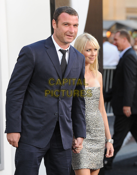LIEV SCHREIBER & NAOMI WATTS.Premiere of SALT held at The Grauman's Chinese Theatre in Hollywood, California, USA. .July 19th, 2010         .half length strapless silver dress black suit holding hands couple grey .CAP/RKE/DVS.©DVS/RockinExposures/Capital Pictures.