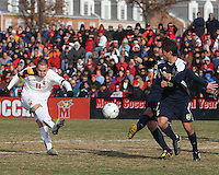 Casey Townsend #11 of the University of Maryland takes a shot past Adam Shaw #5 of the University of Michigan during an NCAA quarter-final match at Ludwig Field, University of Maryland, College Park, Maryland on December 4 2010.Michigan won 3-2 AET.