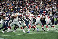 FOXBORO, MA - OCTOBER 10: New York Giants Quarterback Daniel Jones (8) passes under pressure during a game between New York Giants and New England Patriots at Gillettes on October 10, 2019 in Foxboro, Massachusetts.