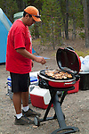 Cooking on the grill while camping.