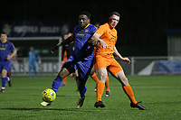 Lheureux Menga of Romford and Pat Ahern of Brentwood during Romford vs Brentwood Town, BetVictor League North Division Football at Parkside on 11th February 2020