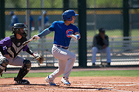 Chicago Cubs catcher Jonathan Soto (2) follows through on his swing during an Extended Spring Training game against the Colorado Rockies at Sloan Park on April 17, 2018 in Mesa, Arizona. (Zachary Lucy/Four Seam Images)