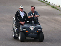 Feb 22, 2014; Chandler, AZ, USA; NHRA official Graham Light (left) and Bob Lang during qualifying for the Carquest Auto Parts Nationals at Wild Horse Pass Motorsports Park. Mandatory Credit: Mark J. Rebilas-USA TODAY Sports
