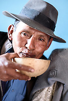A man who has been drinking copious amounts of chicha, the traditional Bolivian alcoholic drink made of fermented corn.