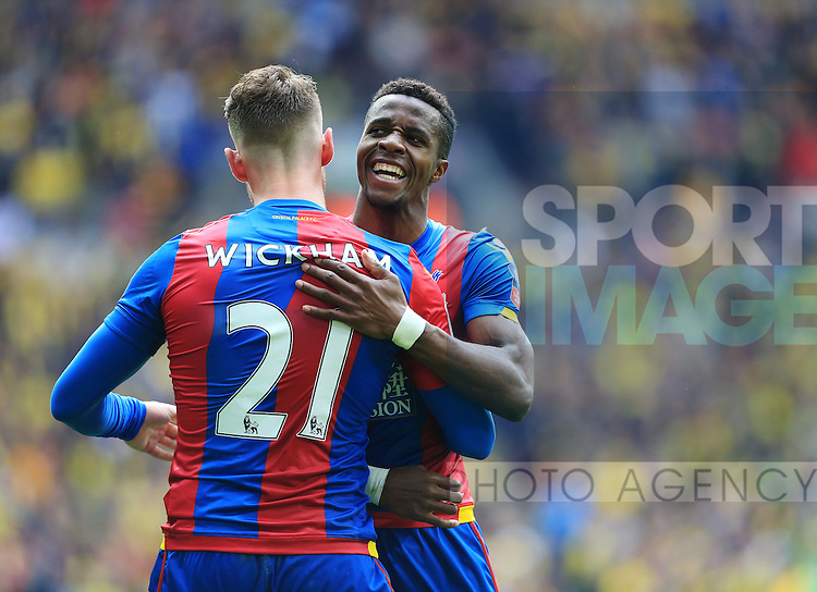 Crystal Palace's Connor Wickham celebrates with Wilfred Zaha during the Emirates FA Cup, Semi-Final match at Wembley Stadium, London.  Photo credit should read: David Klein/Sportimage