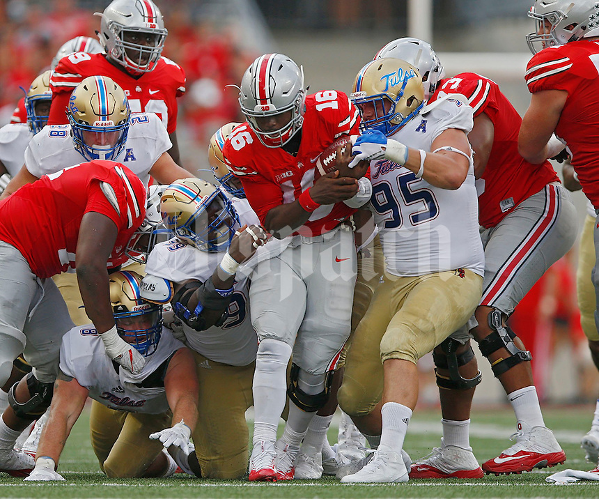 Ohio State Buckeyes quarterback J.T. Barrett (16) is brought down in the second quarter of  an NCAA football game between the Ohio State Buckeyes and the Tulsa Golden Hurricane at Ohio Stadium on Saturday, September 10, 2016. (Columbus Dispatch photo by Fred Squillante)