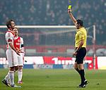 Nederland, Amsterdam, 20 januari 2013.Eredivisie.Seizoen 2012-2013.Ajax-Feyenoord.Scheidsrechter Pol van Boekel deelt een gele kaart uit aan Siem de Jong, aanvoerder van Ajax.