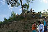 Pará State, Brazil. Aldeia Apyterewa (Parakana). People of the village at the riverside.