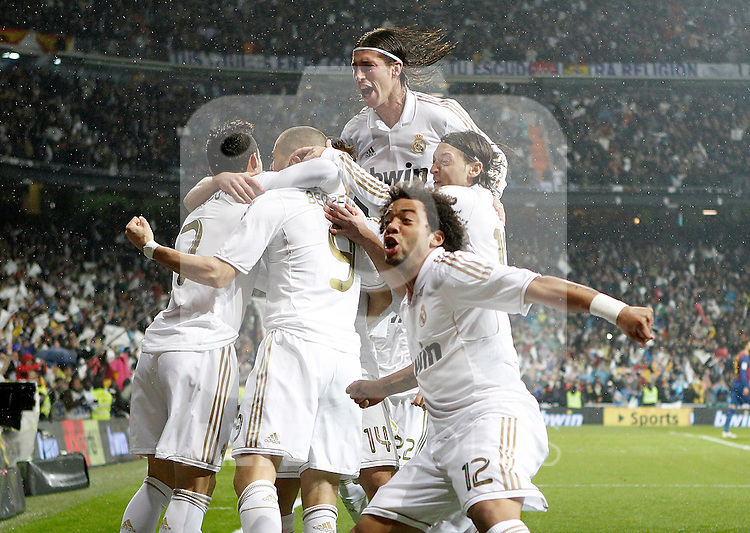 Real Madrid's Marcelo. Sergio Ramos, Mesut Özil and Karim Benzema celebrate with other players during La Liga Match. December 10, 2011. (ALTERPHOTOS/Alvaro Hernandez)