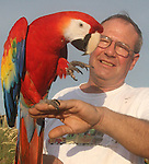 Gary Wilcox/staff...07/16/07.... Allan Weseman  (cq) and his bird Clifford listen to the Smooth Sounds of Hot Summer Nights Summer jazz concert last Sunday at the SeaWalk Pavilion in Jacksonville Beach. The Headliner was saxophonist Michael Lington Jazz guitarist Joyce Cooling and Kai Alece...