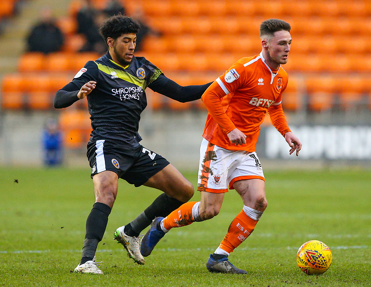 Blackpool's Jordan Thompson gets away from Shrewsbury Town's Josh Laurent<br /> <br /> Photographer Alex Dodd/CameraSport<br /> <br /> The EFL Sky Bet League One - Blackpool v Shrewsbury Town - Saturday 19 January 2019 - Bloomfield Road - Blackpool<br /> <br /> World Copyright © 2019 CameraSport. All rights reserved. 43 Linden Ave. Countesthorpe. Leicester. England. LE8 5PG - Tel: +44 (0) 116 277 4147 - admin@camerasport.com - www.camerasport.com