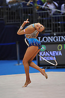 September 7, 2009; Mie, Japan;  Evgeniya Kanaeva of Russia performs with hoop during qualification round at 2009 World Championships Mie. Evgeniya became world champion 4-days later at Mie and was the 2008 gold individual medalist in rhythmic gymnastics at the Beijing Olympics. Photo by Tom Theobald .