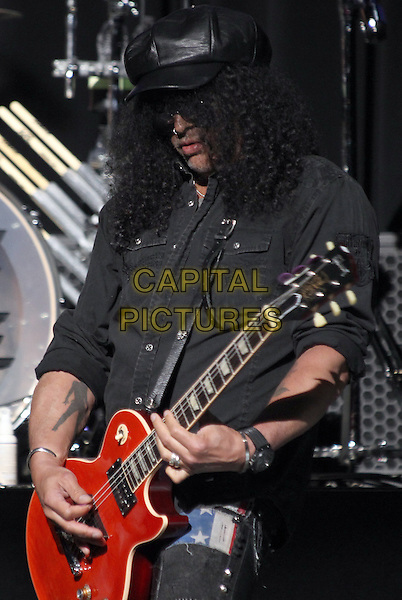 Los Angeles, CA - May 12: Slash Attending 2014 MusiCares MAP Fund Benefit Concert - Show At Club Nokia  California on May 12, 2014.  <br /> CAP/MPI/RTNUPA<br /> &copy;RTNUPA/MediaPunch/Capital Pictures