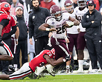 ATHENS, GA - NOVEMBER 23: J.R. Reed #20 of the Georgia Bulldogs tackles Isaiah Spiller #28 of the Texas A