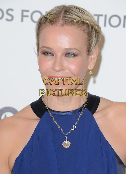 Chelsea Handler.The 21st Annual Elton John AIDS Foundation Academy Awards Viewing Party held at The City of West Hollywood Park in West Hollywood, California, USA..February 24th, 2013.oscars headshot portrait black blue sleeveless gold necklace hair up braids plaits .CAP/DVS.©DVS/Capital Pictures.