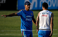 BARRANQUILLA - COLOMBIA - 20 – 03 - 2017: James Rodriguez (Der.), jugador de la Selección Colombia, recibe instucciones de Patricio Camps (Izq.), integrante del cuerpo técnico, durante entreno en las canchas del Polideportivo Universidad Autonoma del Caribe. El equipo colombiano se prepara en Barranquilla para el partido contra el seleccionado de Bolivia el 23 de marzo, partido clasificatorio a la Copa Mundial de la FIFA Rusia 2018. / James Rodriguez (R), Colombia national team player, receives instructions from Patricio Camps (L), member of the coaching staff, during a training in the grounds of the Sports Center of Autonoma del Caribe University. Colombia team prepares in Barranquilla for the match against the national team of Bolivia on March 23, qualifying for the FIFA World Cup Russia 2018. Photo: VizzorImage / Luis Ramirez/ Staff.