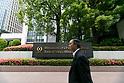 A man walks past a signboard of Bank of Tokyo-Mitsubishi UFJ on display outside its building on May 17, 2017, Tokyo, Japan. Japan's biggest bank plans to shorten its name by dropping ''Tokyo'' to Bank of Mitsubishi UFJ. (Photo by Rodrigo Reyes Marin/AFLO)