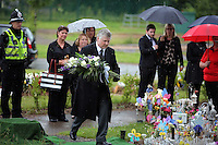 Pictured: An undertaker leaves flowers at the burial site at Thornhill Cemetery, Cardiff, Wales, UK. Tuesday 28 June 2016<br /> Re: The funeral of Sion, the baby boy found dead in the River Taff in Cardiff has taken place<br /> Generous locals raised nearly &pound;1,400 for the memorial after reading about plans to hold a fitting ceremony for the newborn baby whose body was discovered in Cardiff a year ago.<br /> The funeral took place at the Briwnant Chapel at Thornhill Crematorium, Cardiff. Members of the public are invited to be among the congregation.