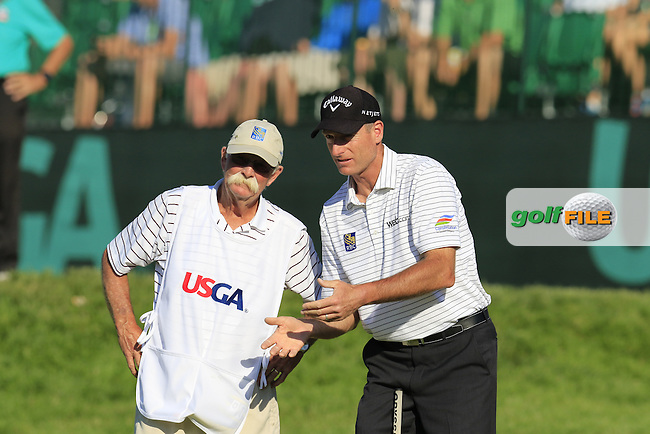 Jim Furyk (USA) and caddy Fluff on the 18th green during Friday's Round 2 of the 2016 U.S. Open Championship held at Oakmont Country Club, Oakmont, Pittsburgh, Pennsylvania, United States of America. 17th June 2016.<br /> Picture: Eoin Clarke | Golffile<br /> <br /> <br /> All photos usage must carry mandatory copyright credit (&copy; Golffile | Eoin Clarke)