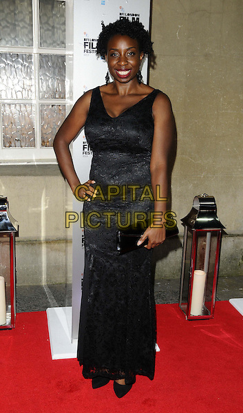 Destiny Ekaragha<br /> attended the BFI London Film Festival Awards 2013, 57th BFI London Film Festival day 11, Banqueting House, Whitehall, London, England, UK, 19th October 2013.<br /> full length black dress hand on hip long maxi clutch bag <br /> CAP/CAN<br /> &copy;Can Nguyen/Capital Pictures