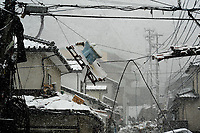 A toilet rests on top of some power lines on March 16, 2011 in Ofunato, Japan, after a 9.0 earthquake hit Japan on March 11 that caused a tsunami that destroyed anything in its path.
