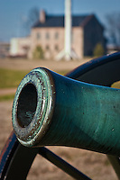 A canon in front of the Commissary building at the Fort Smith National Historic Site.