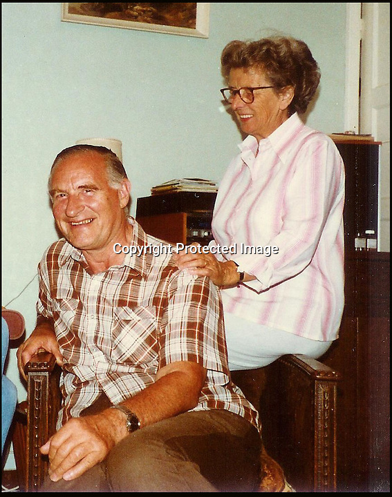 BNPS.co.uk (01202 558833)<br /> Pic: BourneEnd/BNPS<br /> <br /> ***Please use full byline***<br /> <br /> Gerald with watch and wife Lesley in the 1980's<br /> <br /> A Rolex watch worn by a British prisoner of war during the infamous 'Great Escape' attempt is tipped to sell for &pound;30,000.<br /> <br /> Despite being held in the Stalag Luft III camp in Germany, Flight Lieutenant Gerald Imeson was still able to order and take delivery of a brand new watch in 1942.<br /> <br /> The famous Swiss watchmaker had offered all British officers one of their timepieces to replace the ones seized by the Germans and they could be paid for after the war.<br /> <br /> F/Lt Imeson helped dig the three tunnels for the audacious escape attempt of 1944.