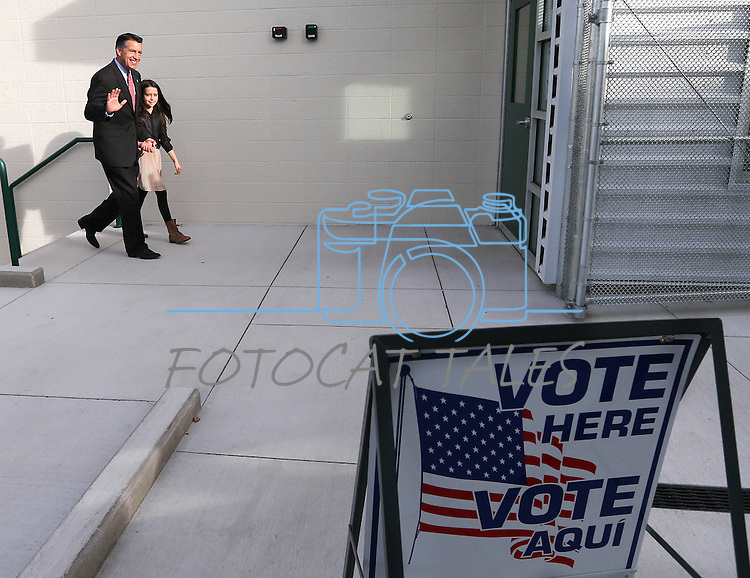 Nevada Gov. Brian Sandoval and his daughter Marisa, 10, arrive at the polls in Reno, Nev., on Tuesday, Nov. 4, 2014. Sandoval is expected to cruise to re-election over a little-known Democrat. (AP Photo/Cathleen Allison)