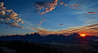 The summer sun slips over the Teton Range and Jackson Lake from my camp in Bridger National Forest, Wyoming.  July 2012.