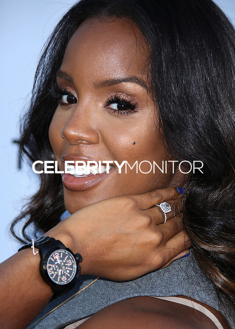 LOS ANGELES, CA, USA - SEPTEMBER 04: Singer Kelly Rowland showcases the new TW Steel Canteen bracelet watch at Feldmar Watch Company on September 4, 2014 in Los Angeles, California, United States. (Photo by Xavier Collin/Celebrity Monitor)