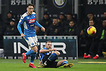 Milan Skriniar of Inter plays the ball back to goalkeeper Daniele Padelli, under pressure from Piotr Zielinski of Napoli during the Coppa Italia match at Giuseppe Meazza, Milan. Picture date: 12th February 2020. Picture credit should read: Jonathan Moscrop/Sportimage