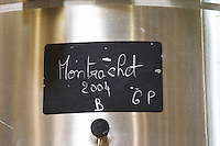 A stainless steel fermentation vat with a black chalk board with text in chalk Montrachet Grand Cru 2004, Maison Louis Jadot, Beaune Côte Cote d Or Bourgogne Burgundy Burgundian France French Europe European