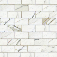 "Running Bond, a hand-cut stone mosaic, shown in polished 3"" x 6"" Calacatta."