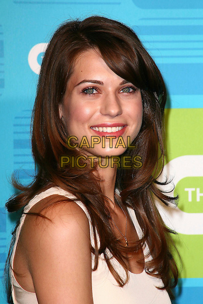 LYNDSY FONSECA .AT the 2010 The CW Network UpFront at Madison Square Garden on May 20, 2010 in New York City,  New York, NY, USA, 20th May 2010..portrait headshot smiling cream beige .CAP/ADM/PZ.©Paul Zimmerman/AdMedia/Capital Pictures.